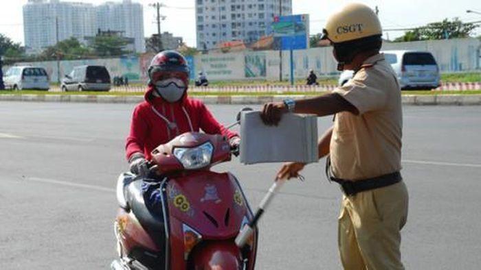 Mức phạt tăng lên đòi hỏi người dân phải tuân thủ nghiêm ngặtluật giao thông -Xe máy vượt đèn vàng sẽ bị phạt